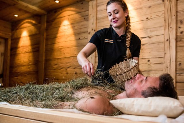 Mann Geniesst Heumassage C Dejori Werner Hotel Granbaita Dolomites